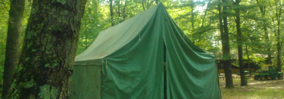 The front of a large green tent on a platform at the Jack Pine tent site.